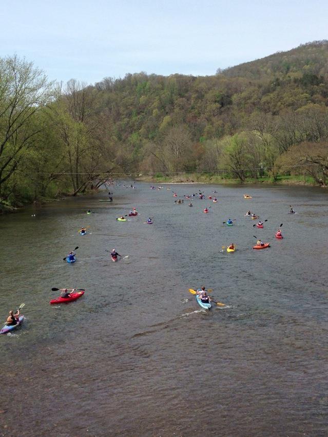 kayaks down river