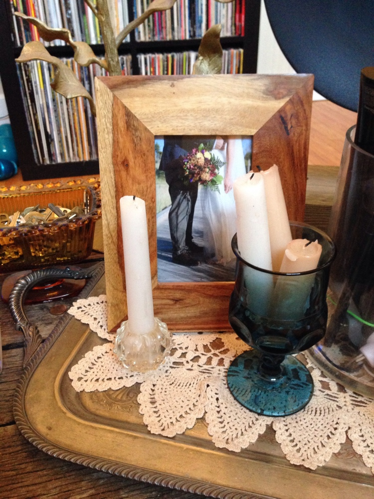 Another centerpiece cup holds more ceremony candles.