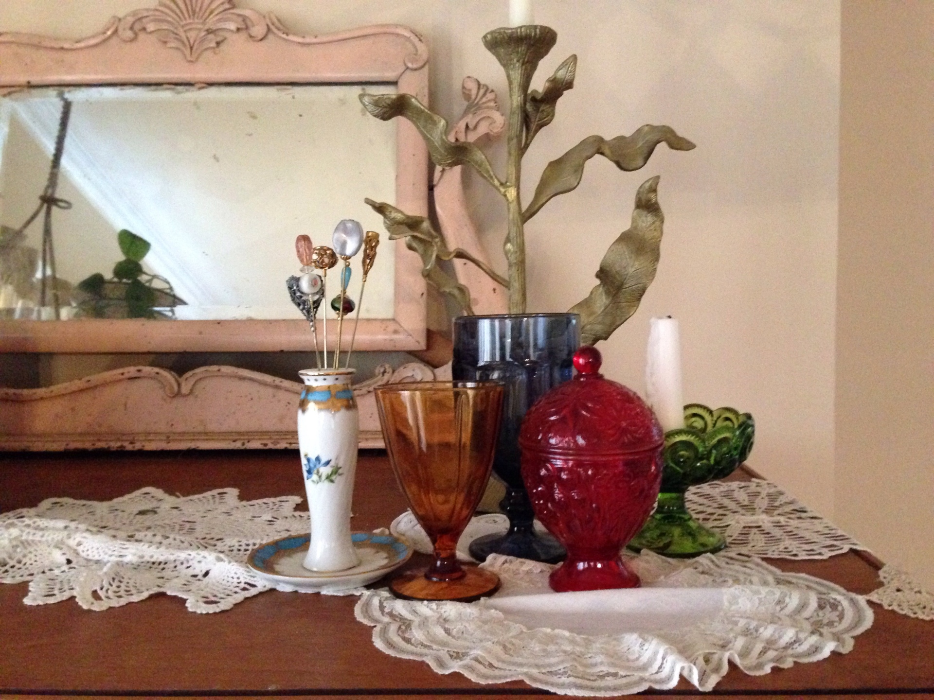 The thrifted jars that made up our centerpieces now decorate the top of an armoire in our dining room...